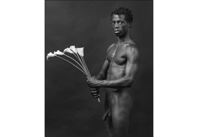 Robert Mapplethorpe, Dennis with Flowers, 1983. The Robert Mapplethorpe Foundation, New York